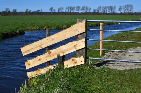 leidschendam: The farmer has made new boards to the fence in a pasture in Leidschendam, The Netherlands. Stock Photo