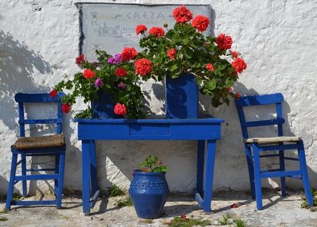 Typical greek courtyard with blue flower pots in Piskopiano on Crete, Greece. Stock Photo