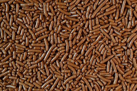 Micro photo of chocolate sprinkles. photo