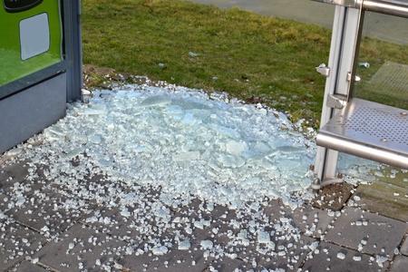 The pane in a bus stop is broken by vandals Leidschendam, Netherlands