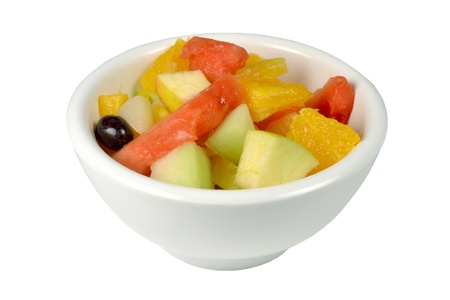 Fresh fruit salad in a bowl on a white background.