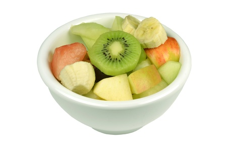 Fresh fruit salad in a bowl on a white background  Stock Photo