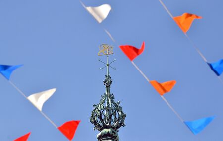The tower of the town hall with flags on Queen s day in Leiden, Netherlands
