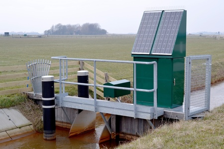 Drainage pumping station into a ditch on Texel, Netherlands  photo
