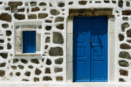 Door of a church in Red Beach on the island of Santorini in Greece  Stock Photo