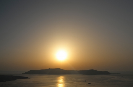 thira: Sunset in Thira at Santorini island in Greece