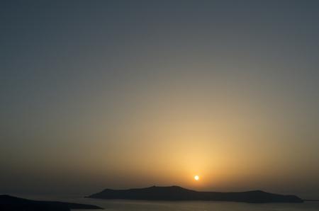 thira: Sunset in Thira at Santorini island in Greece
