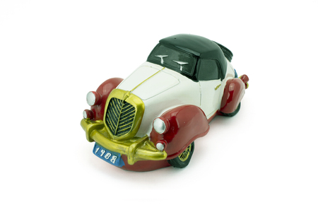 Antique model car on a white background