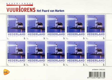 marken: NETHERLANDS - JANUARY 5 - 2014  Stamp printed in The Netherlands shows the lighthouse of Marken  The lighthouse exists 175 years  Editorial