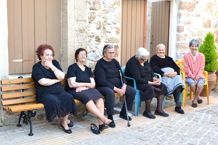 autochthonous: GREECE - CRETE - MALIA - CIRCA MAY 2011  Elderly women seek each other s company  Editorial