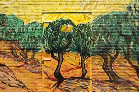 van gogh: NETHERLANDS - WASSENAAR - CIRCA MAY 2014  Painters of the group  Rembrandt Paintings  have a power house painted with the painting  Olive trees with yellow sky and sun from Vincent van Gogh  Editorial