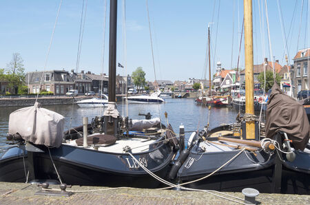 lemmer: NETHERLANDS - LEMMER - CIRCA MAY 2014   Luxury sailboats are docked at the port of Lemmer  Editorial