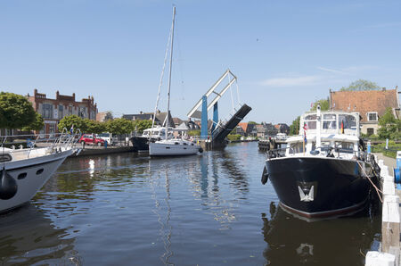Pleasure yachts in the port of Lemmer in Friesland, Netherlands
