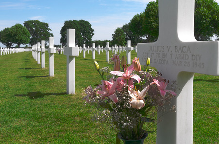 NETHERLANDS - MARGRATEN - CIRCA JUNE 2014  Flowers on a grave of a fallen U S  soldier at the Netherlands American Cemetery and Memorial  Sajtókép