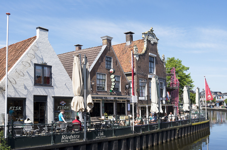 lemmer: NETHERLANDS - LEMMER - CIRCA MAY 2014  People on a terrace in the center of Lemmer