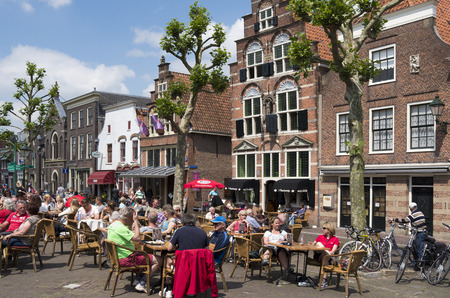 NETHERLANDS - OUDEWATER  - CIRCA JUNE -2014  People on a terrace in the center of the village Oudewater