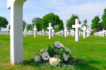 NETHERLANDS - MARGRATEN - CIRCA JUNE 2014  Flowers on a grave of a fallen U S  soldier at the Netherlands American Cemetery and Memorial  Editorial
