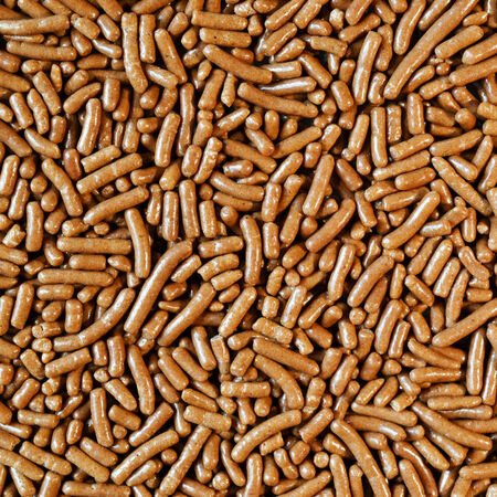 chocolate sprinkles: Micro photo of chocolate sprinkles for background.