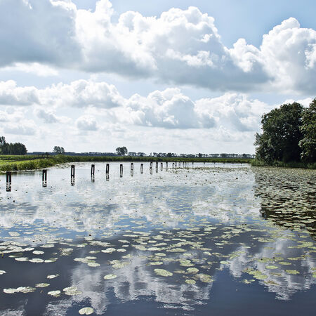 Clouds in a lake around a castle in Bodegraven, The Netherlands. Stock Photo