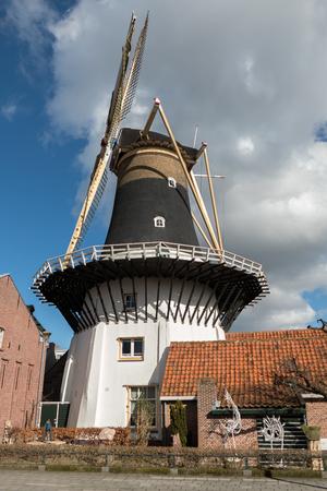 cultural history: NETHERLANDS - WASSENAAR - CIRCA MARCH 2015: Mill Windlust with sculpture garden. Editorial