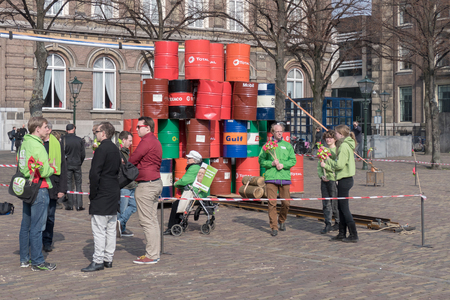 political party: NETHERLANDS - THE HAGUE - MARCH 2015: Wind energy action from political party Green Left on the square in The Hague for a cleaner environment for the provincial elections.