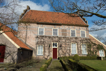 smallest: NETHERLANDS - BRONCKHORST - CIRCA MARCH 2015: Historic mansion in the smallest town of The Netherlands.