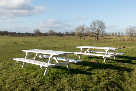 picknick: Picnick tables in a pasture at Bronckhorst in Netherlands. Stock Photo