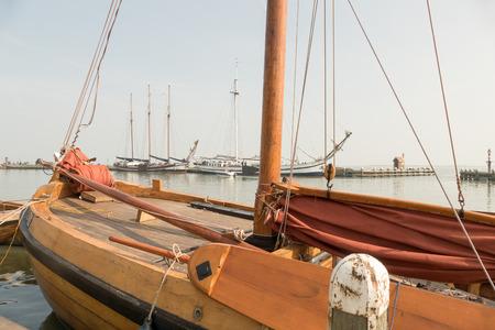 volendam: NETHERLANDS - VOLENDAM - CIRCA APRIL 2015: Sailing yachts in the harbor.