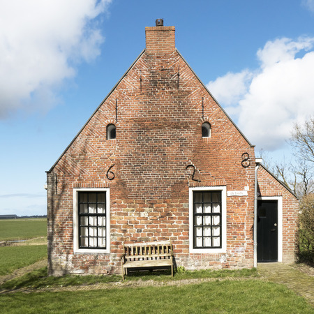 cultural history: NETHERLANDS  JANNUM  CIRCA APRIL 2015: Terp house from 1628 in Friesland. Editorial