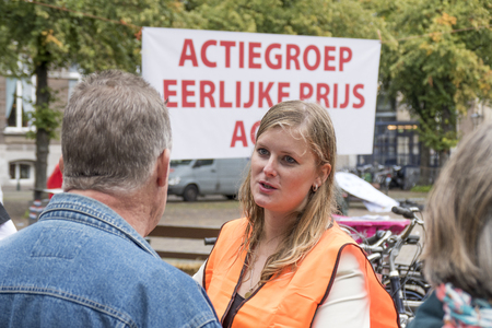 dissatisfaction: NETHERLANDS - THE HAGUE - 3 SEPTEMBER 2015: Pig farmers ask in The Hague with a publicity campaign highlighting the difficult situation of the pig industry. Ham sandwiches were distributed.