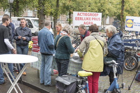 NETHERLANDS - THE HAGUE - 3 SEPTEMBER 2015: Pig farmers ask in The Hague with a publicity campaign highlighting the difficult situation of the pig industry. Ham sandwiches were distributed.