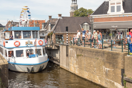 NETHERLANDS - LEMMER - MEDIA AUGUST, 2015: Tour boat by the old lock in Lemmer in Friesland in the north of Netherlands.