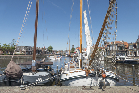 NETHERLANDS - LEMMER - MEDIA AUGUST 2015: Pleasure yachts and sailboats in the port of Lemmer in Friesland, Netherlands. Editorial