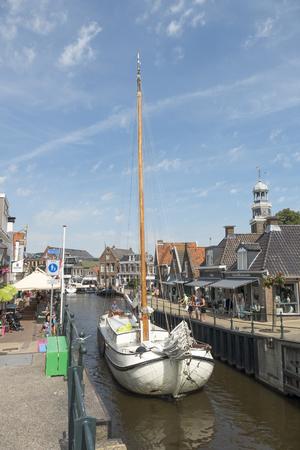 lemmer: NETHERLANDS - LEMMER - MEDIA AUGUST, 2015: Sailboat by the old lock in Lemmer in Friesland in the north of Netherlands. Editorial
