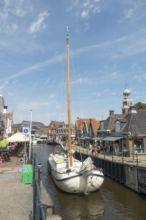 NETHERLANDS - LEMMER - MEDIA AUGUST, 2015: Sailboat by the old lock in Lemmer in Friesland in the north of Netherlands. Editorial