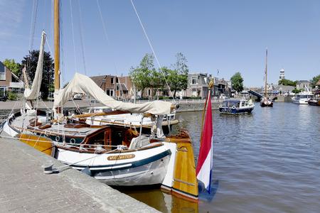 lemmer: NETHERLANDS - LEMMER - MEDIA AUGUST 2015: Pleasure yachts and sailboats in the port of Lemmer in Friesland, Netherlands. Editorial