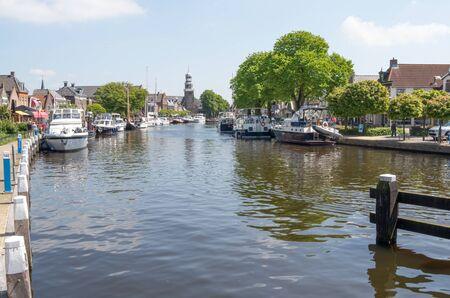 lemmer: NETHERLANDS - LEMMER - MEDIA MAY 2014: Pleasure yachts and sailboats in the port of Lemmer in Friesland, Netherlands.
