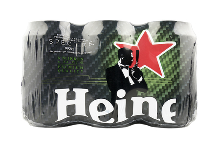 spectre: LEIDSCHENDAM - NETHERLANDS - MEDIA OCTOBER 2015: 6-pack of Heineken beer cans, with advertising for the James Bond movie Spectre. Editorial