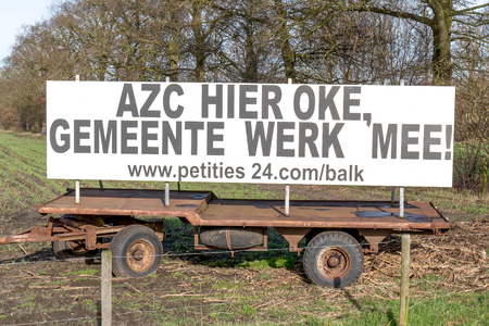 lemmer: LEMMER - NETHERLANDS - MEDIA FEBRUARI 2016: Supporters for the arrival of a refugee camp with the call to complete the petition in Balk, Netherlands. Editorial