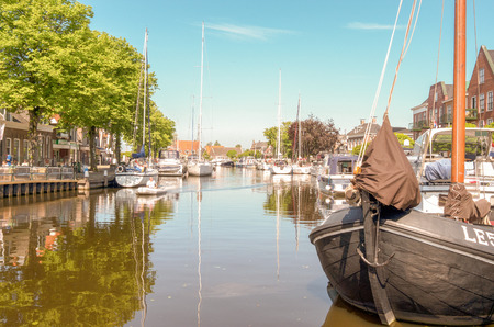 docked: NETHERLANDS - LEMMER - MEDIA MAY 2014: Pleasure yachts and sailboats in the port of Lemmer in Friesland, Netherlands.