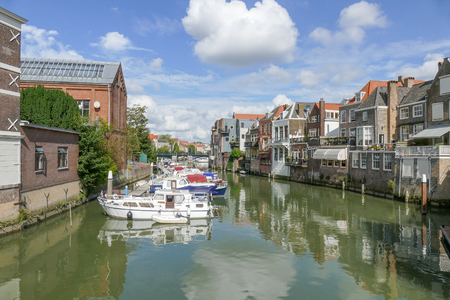 dordrecht: NETHERLANDS - DORDRECHT - MEDIA SEPTEMBER 2016: Canal in Dordrecht with canal houses and boats. Editorial