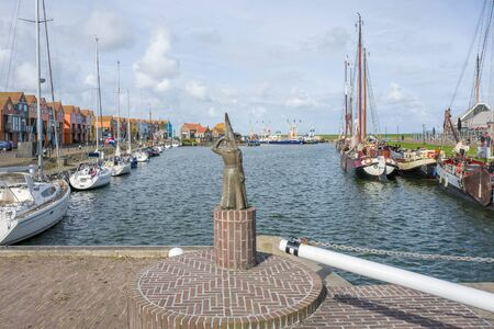 ladys mantle: NETHERLANDS - STAVOREN - MEDIA APRIL 2017: Statue of a the lady of Stavoren looking out over sea. Editorial