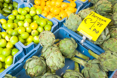 Artichoke and limes on a market in Leiden, Netherlands.
