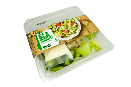 NETHERLANDS - LUNTEREN - JULY 24, 2017: Salad in a bowl from the Coop supermarket store in Lunteren in the Netherlands. On a white background.