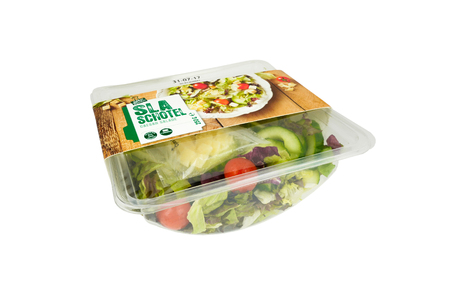 NETHERLANDS - OTTERLO - JULY 26, 2017: Supermarket salad in a bowl, ready to eat, from the Spar supermarket store in Otterlo in the Netherlands. On a white background.