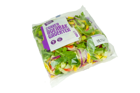 NETHERLANDS - OTTERLO - JULY 26, 2017: Supermarket summer stirring vegetables from the Spar supermarket store in Otterlo in the Netherlands. Isolated on a white background.