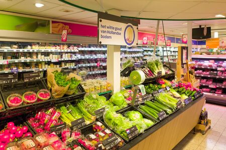 NETHERLANDS - OTTERLO - JULY 26, 2017: Vegetable and fruit department in an Spar store in the center of Otterlo, Netherlands.
