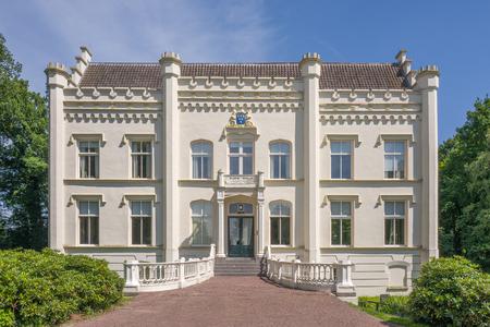 NETHERLANDS - SCHERPENZEEL - JULY 17, 2017: Front of the town hall called Huize Scherpenzeel in Scherpenzeel, Netherlands.