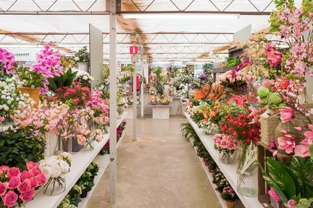 NETHERLANDS - ZOETERMEER - SEPTEMBER 10, 2017: Silk flowers in garden center De Driesprong in Zoetermeer, Netherlands.