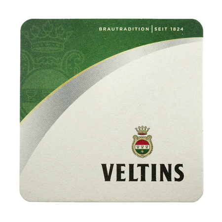 NETHERLANDS - LUNTEREN - JULY 17, 2017: Veltins beermat. From brewery C A Veltins, Germany. Isolated on white background.